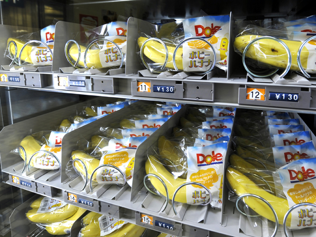TO GO WITH Lifestyle-Japan-retail-vending-machines,FEATURE by Miwa Suzuki This photo taken on August 25, 2010 shows wrapped banana in a vending machine in Tokyo. Dole Japan, Ltd. turned heads when it set up a banana vending machine at a Tokyo train station in June, selling chilled bananas for 130 yen (1.5 USD) each or a bunch of about five for 390 yen. They sell umbrellas, flowers and cooked meals, cough up cool drinks after earthquakes and, as of late, even try to read your mind: they are Japan's five million vending machines. AFP PHOTO / Kazuhiro NOGI (Photo credit should read KAZUHIRO NOGI/AFP/Getty Images)